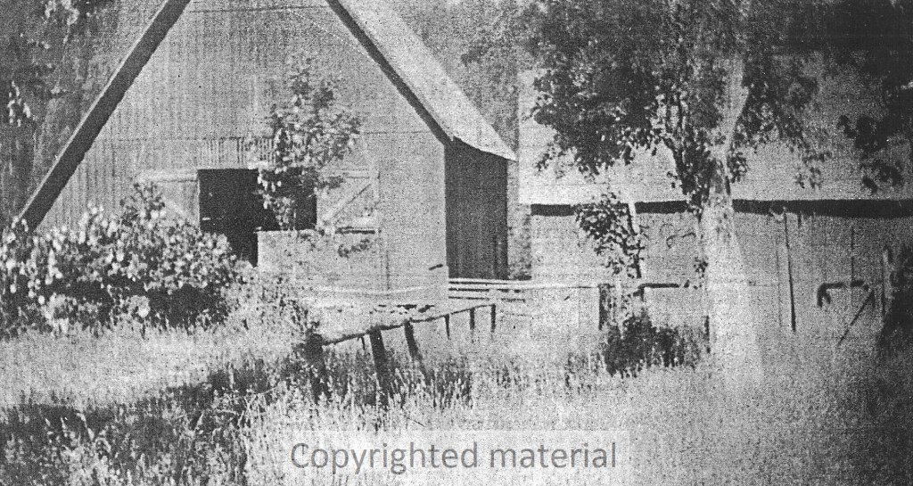 Barn, built in 1878, and carriage house (right).