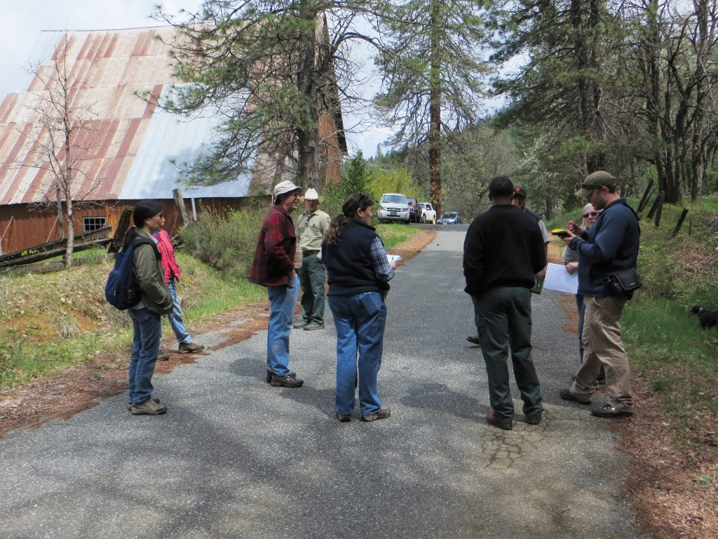 Volunteers and Forest Service members map and discuss the interpretive trail.